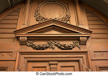 Carved solid wood door in the centre of Lviv