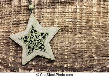 Carved stars on a wooden background