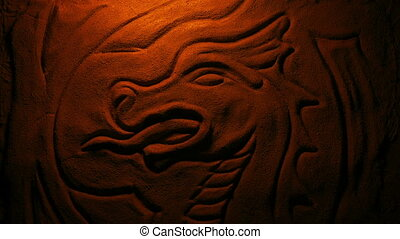Carved Stone Dragon In Fire Glow