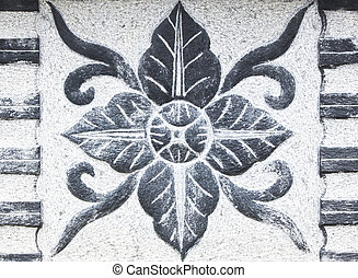 Carved stone flower shape