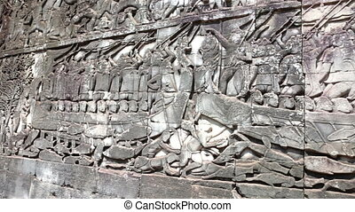 Carved Stone images on Bayon Temple, Siem reap, Cambodia.