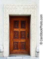 carved stone wall door