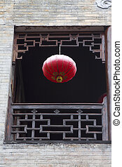 Carved window frames and red lanterns in the Phoenix Town