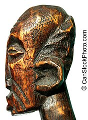 Carved wooden head - Isolated old carved wooden head on ...