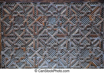 Carved wooden pattern in Madrasa Bou Inania wooded