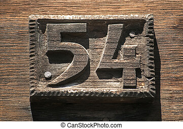 Carved wooden plate number 54