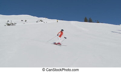 carving after steadycam - female skier carving on nearky...