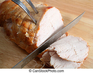 Carving boneless turkey joint - Carving a joint of boneless...