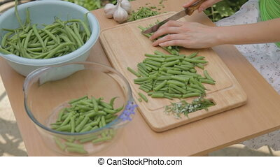 Carving fresh green beans outdoors
