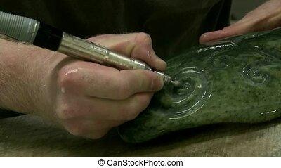 Carving Greenstone.