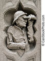 Carving of an old man on a building