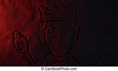 Carving Of King In Firelight Zoom Out - Fire lights up a...