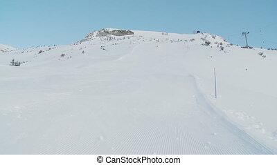 carving on ski piste in the morning