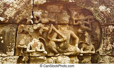 Carving on the wall of ancient temple. Angkor. Cambodia -...