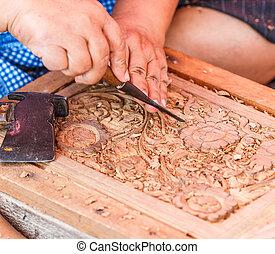Carving wood - carpenter