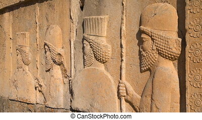 Carvings from the city of persepolis - A shot of the...