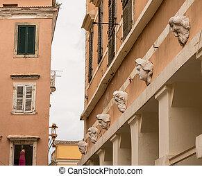 Carvings on side of Bazaar in Old Town Corfu