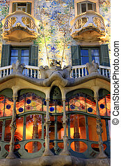 Famous creation by Gaudi (1904) for the industrialist Josep Batllo. Covered in colorful tiny pieces of mosaic and stained glass windows.