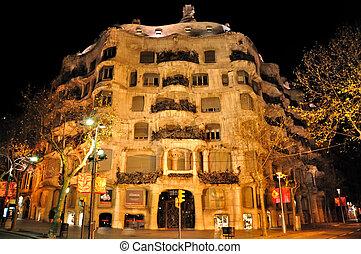 Barcelona, Spain - Casa Mila at night in Barcelona, Spain. A...