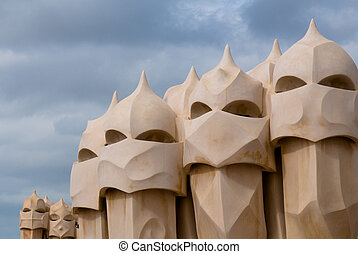 Casa Mila, Barcelona, Spain - Details of funnels on top of...