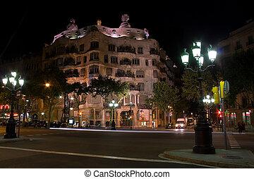 Casa Mila building at night in Barcelona, Spain