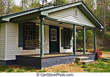 casa pequeña, pórche de entrada