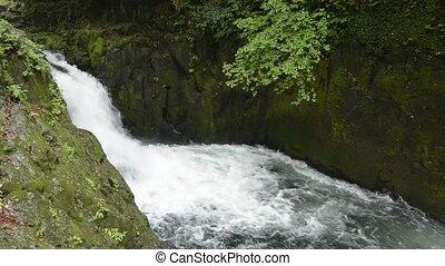 Cascade between the rock walls - Rapid flowing small cascade...