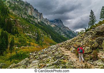 Female Hiker hiking Cascade Canyon in Grand Tetons