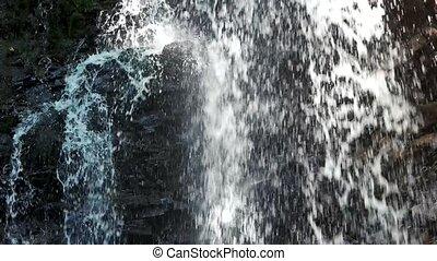 Cascade closeup, water flow in slow motion.