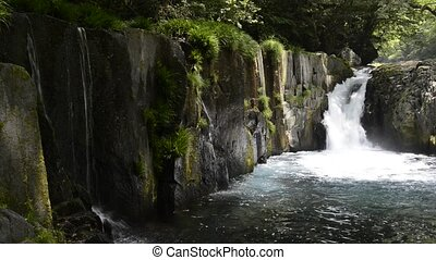 Cascade falling - Cascade flowing between the rocks and...