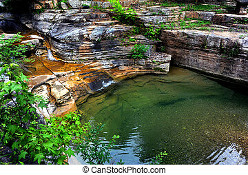 Cascade in the Ozarks - Water cascades from a Ozark Mountain...
