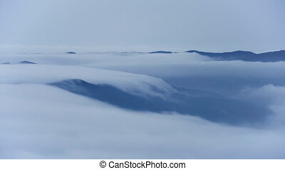 Cascade of clouds. Sea of clouds in mountainous landscape,...