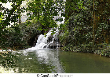 cascade over small lagoon