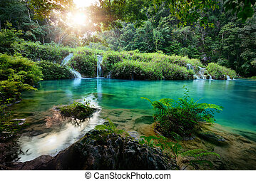Cascades National Park in Guatemala Semuc Champey at sunset.