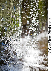 cascades of water in the sunshine