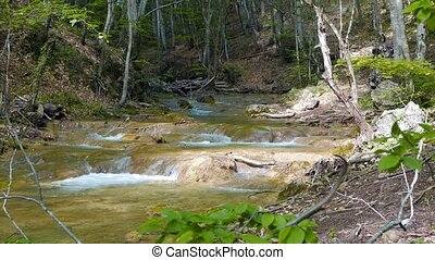 Cascades on the river. Grand Canyon of Crimea. Mountain...