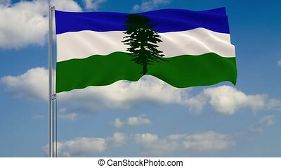 Cascadia flag against background of clouds floating on the blue sky