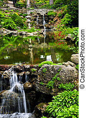 Cascading waterfall and pond in japanese garden