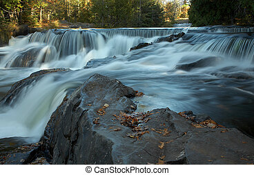 Cascading Waterfalls in early Autumn in Michigan\\\'s Upper...