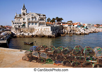 Cascais Bay - Fishing traps and anchored fishing boat in a...