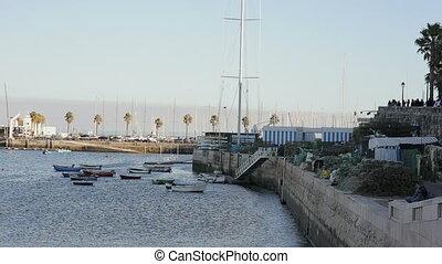 cascais fish boat marina, evening, fishing nets and coloful...