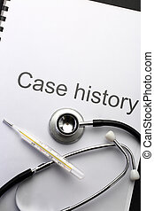Case history, stethoscope and thermometer on black