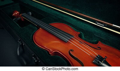 Case Opens And Violin Is Taken Out - Performer opens case...