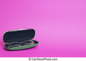 Case with glasses on a pink background