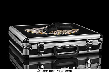 Case with money and gun - Silver case with money and gun on...