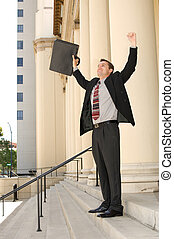 Case won - Attorney standing on the courthouse steps with...