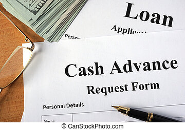 Cash advance form on a wooden table.