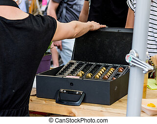 Cash box with euro coins.