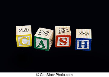 Cash - Building blocks spelling the word cash