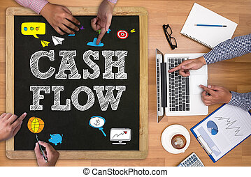 CASH FLOW Businessman working at office desk and using...